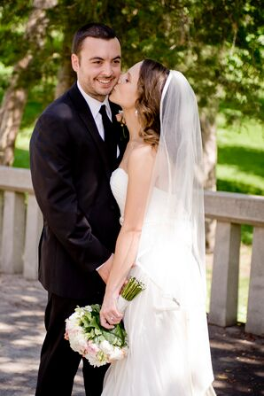 Bride and Groom Kiss on the Cheek