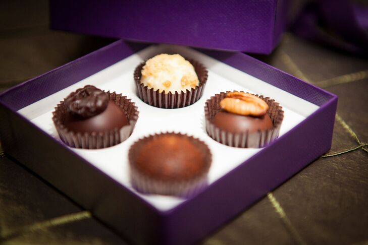 Stanley and Jason sent their friends and family members home with a few sweet treats, decadent Vosges chocolates wrapped in regal purple boxes. The boxes were displayed on a vintage buffet cart for guests to take as they made their exit.