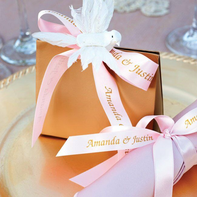 Gold boxes fastened with ribbon and paper doves transformed Jordan almonds into fancy favors.