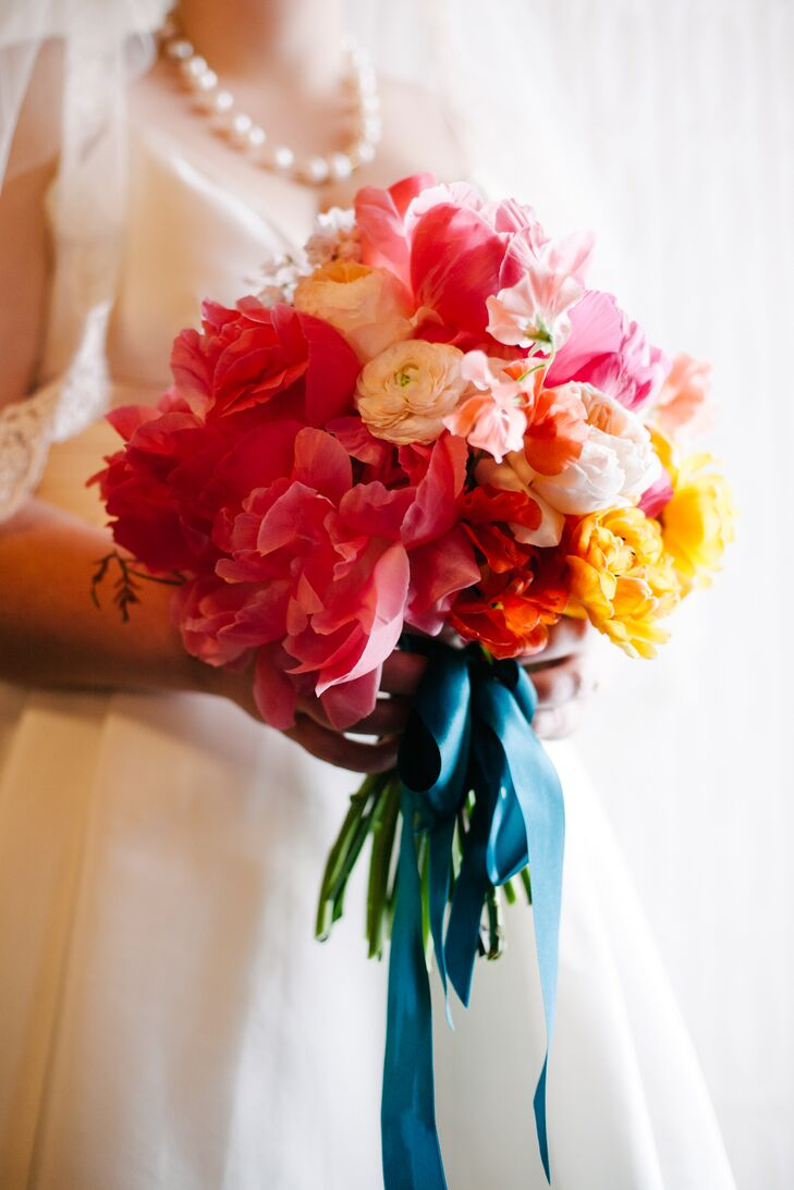 Kimberley carried a colorful bouquet with deep pink peonies (her favorite!) and pops of yellow.