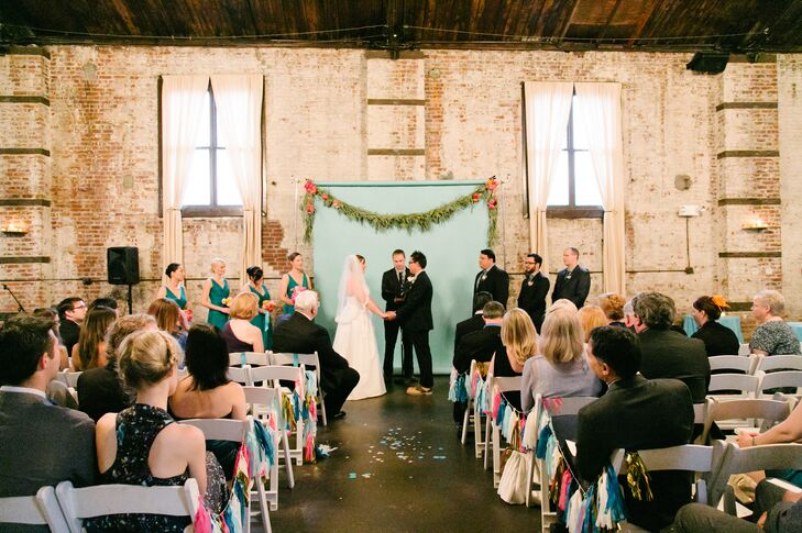 """""""We knew we wanted to get married in Brooklyn—it's our home and the basis of so many highlights in our relationship,"""" says Kimberley. """"Seeking out a non 'cookie cutter' venue, we found the Green Building and it immediately felt right. An old warehouse in the neighborhood of Gowanus, Brooklyn it featured many industrial elements that appealed to our aesthetic."""""""