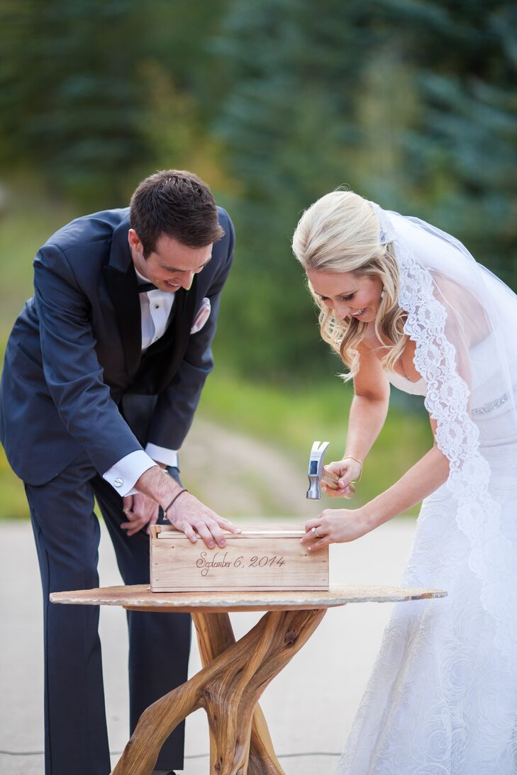 For their unity ceremony, the couple did a wine box tradition. They put a bottle of wine and unopened love letters to each other into the wooden box and nailed each end shut. They will get to decide if they want to open it in one, five or 10 years.