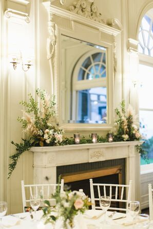 White Mantle with Flower Arrangements and Candles