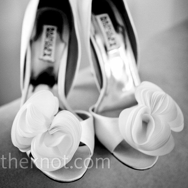 The bride's white satin, open-toe pumps were accented with a flirty silk flower.