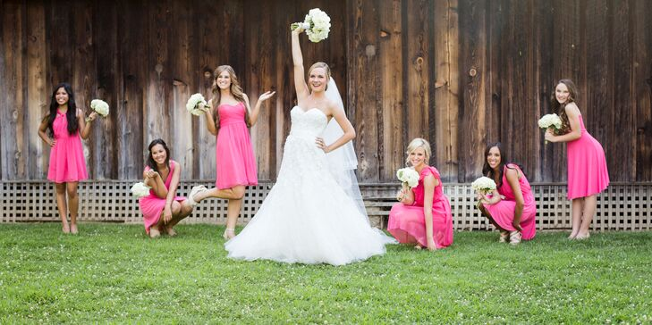 The bridesmaids wore coral dresses with pink undertones from Ann Taylor to play up the coral accents throughout the wedding decor. Each bridesmaid picked out their own style of dress to show off their personality.