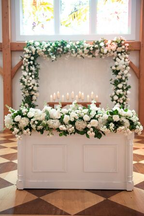 Traditional Ceremony Altar with White Flowers, Greenery and Candles