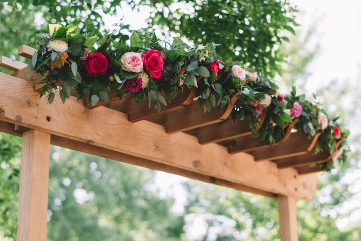 Connie and Kent exchanged vows under a canopy of bright, romantic flowers.