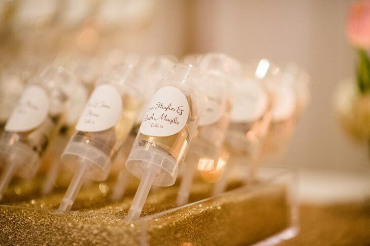 Escort cards were given in the form of poppers filled with gold confetti for the guests to use at midnight.