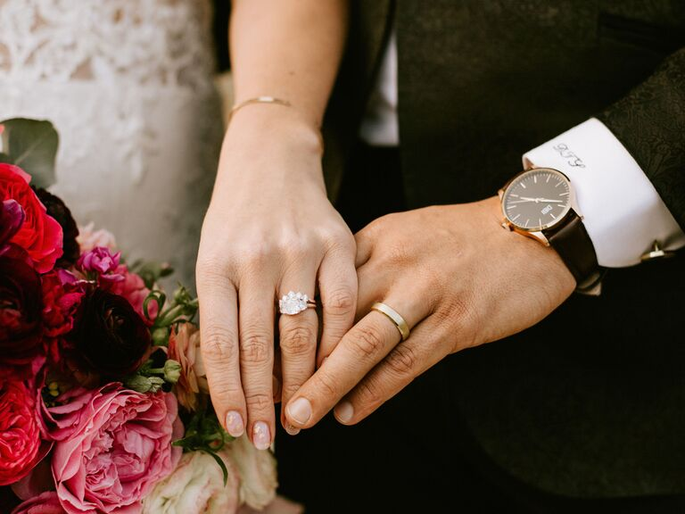 Bride and groom wearing wedding bands