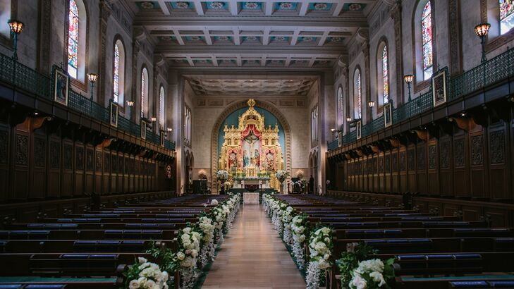 The Catholic ceremony took place at Founders Chapel at the University of San Diego. Overflowing white flowers lined the pews creating a dramatic aisle leading to an ornate alter.