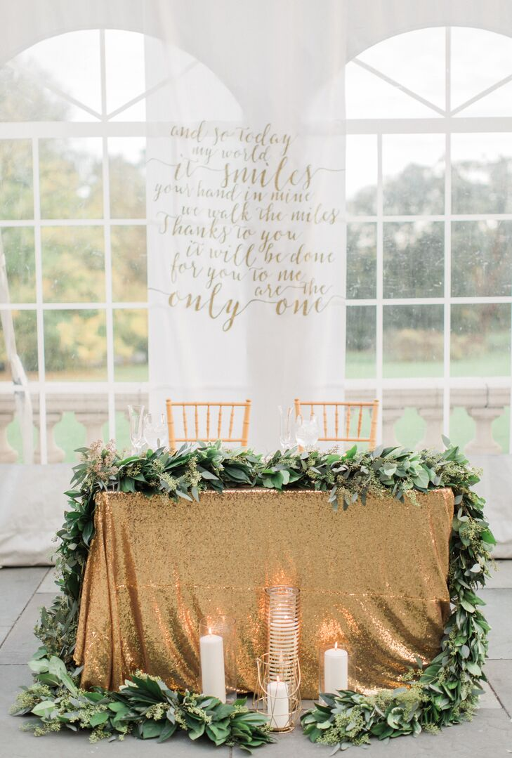 Gold Sequin Sweetheart Table with Lush Green Garland