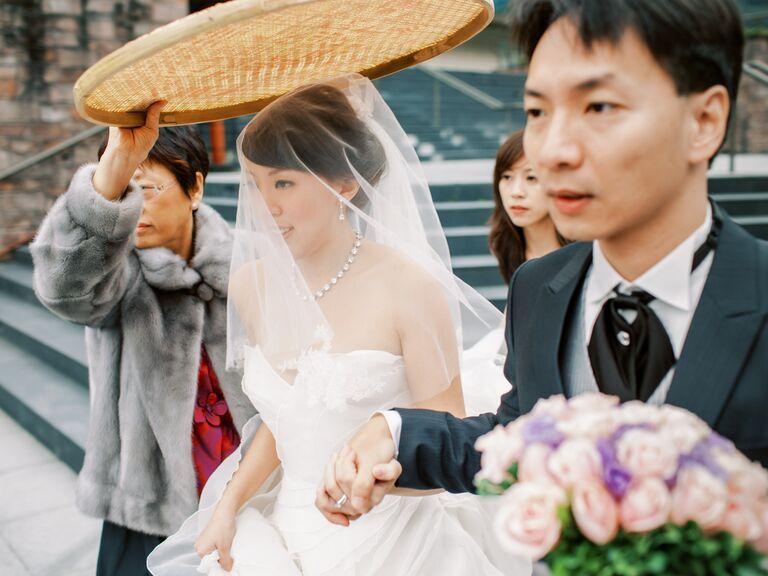 Rice sieve held over bride during wedding