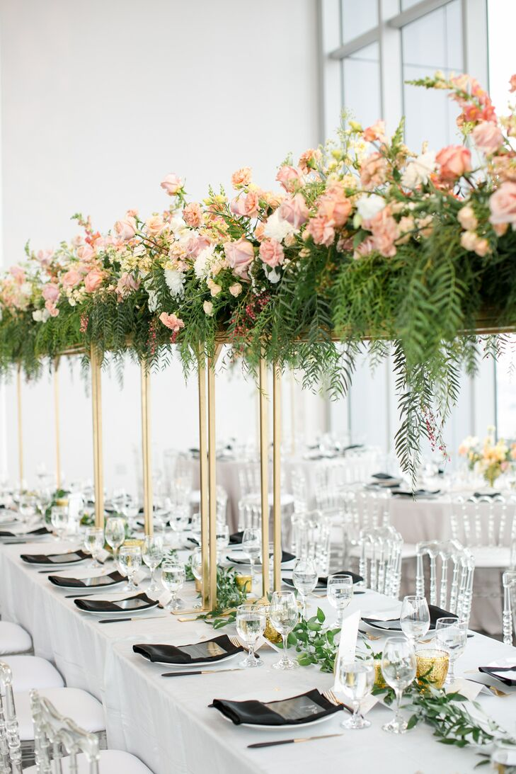 Dining Table with Tall Centerpieces of Pink Roses and Greenery
