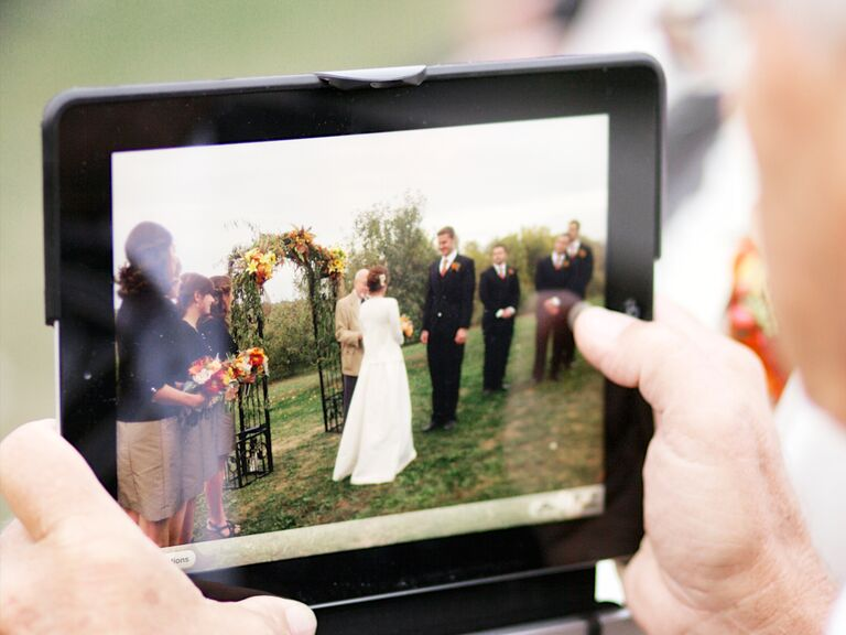 Somone livestreaming the wedding ceremony to guests who aren't there