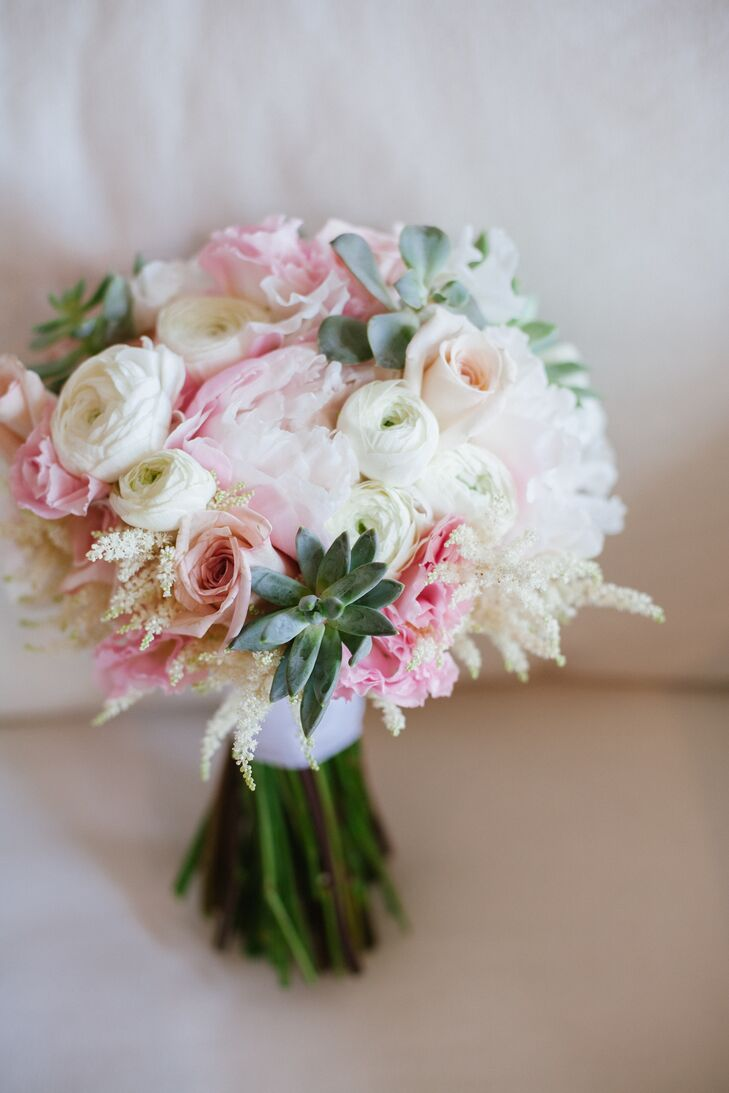 The bride's bouquet was a bright, summery arrangement full of pink, white and peach florals with sage-green accents. So pretty!