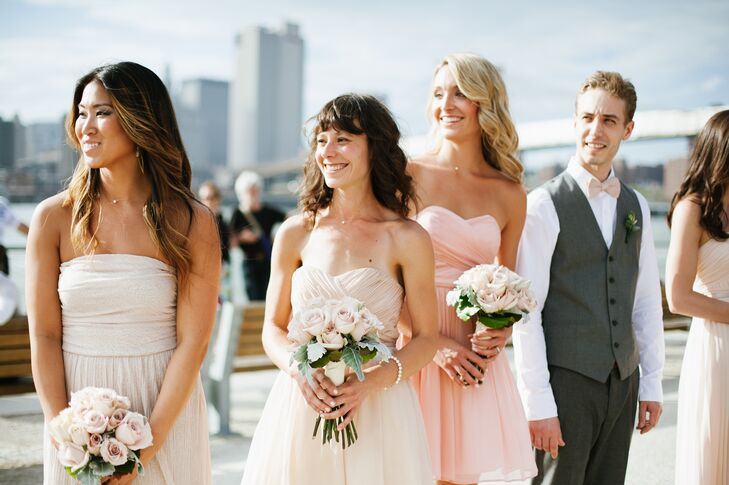 """""""Our bridesmaids wore mismatched pink and nude colored dresses that they picked themselves,"""" Karen says.  """"I bought handmade bow ties from a seller on Etsy for the guys which were sage green, and my sister-in-law stood on Josh's side wearing a sage green dress."""""""