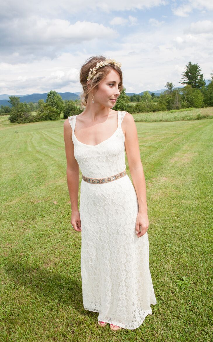 Amy found her dress at Cicada, a small bridal boutique in Seattle, Washington. Amy had small alterations made to the sheath gown to fit her style.