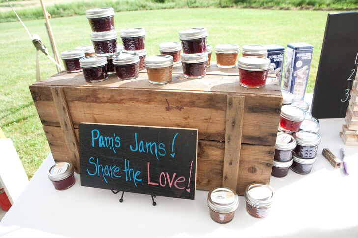 """Amy's mother handmade 150 jam jars for the guests as favors. A small black chalkboard said """"Pam's Jams! Share the Love!"""" in bright, bold colors."""