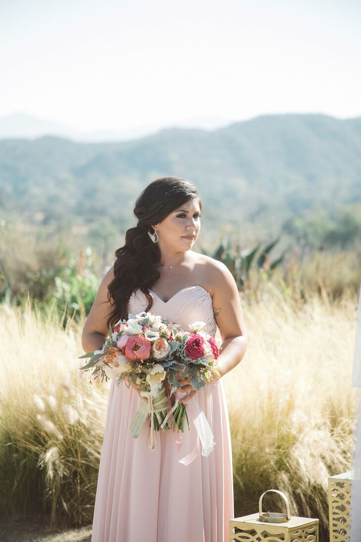 Tracy and Michael's four daughters served as bridesmaids, each wearing a full-length blush strapless gown in varying styles. Their large, naturalistic bouquets were made with garden roses, succulents, ranunculus, eucalyptus and black-center anemones.