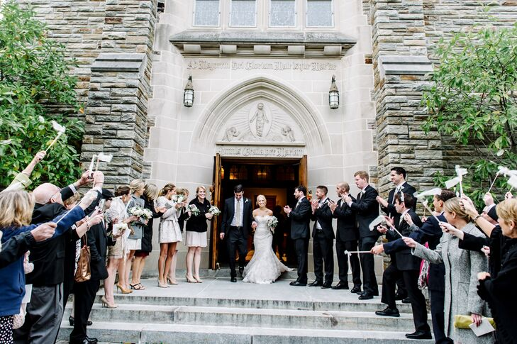 After the ceremony, Corinne and John exited the Alumni Chapel at Loyola University Maryland. Their wedding party stood on both sides of the large doors, awaiting to greet and congratulate the newlyweds.