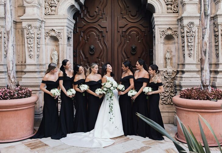 Elegant Bridesmaids with Black Gowns and White Bouquets