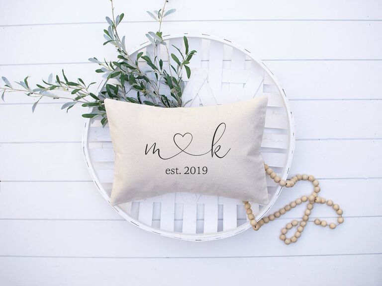 Personalized cotton throw pillow with couple's initials and established date