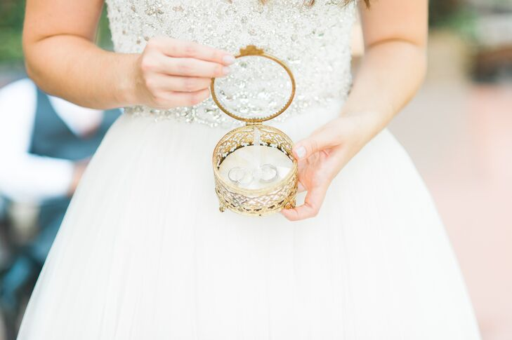 """I also love vintage pieces, and I found a vintage gold filigree box which we used as a ring box,"" Amber says. ""We also had gold utensils for our head table that I found in an antiques store."""