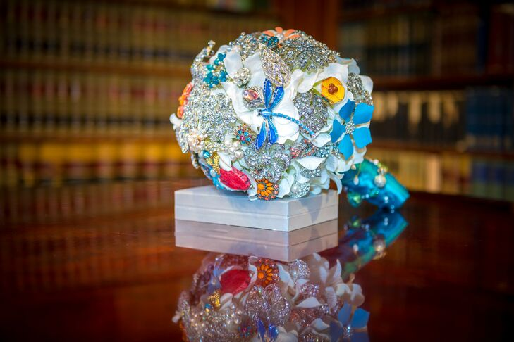 "The brooch bouquet took nearly a year to create. After collecting brooches from family, flea markets, consignment shops and antique shows, Jill hand-wired the pins into ""flowers."""