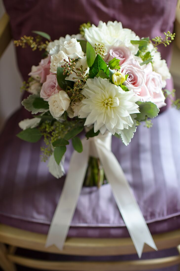 Tricia's bouquet was a soft mix of white dahlias, pastel pink roses and assorted greenery.