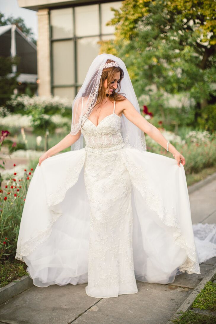 9f10b254f96 Tina chose an elaborately detailed ivory lace YSA Makino wedding dress with  a detachable skirt and