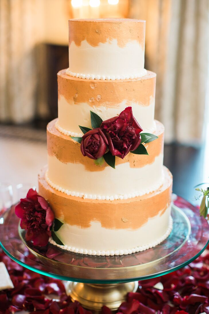 """We loved the gold-painted cake, in traditional wedding cake flavor, which we designed together. It was traditional yet unexpected and tasted divine,"" Keeley says."