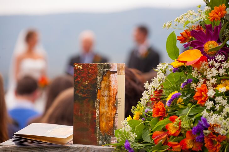 The ceremony programs featured an image of the couple's names carved into wood. Flower arrangements at the ceremony consisted of lilies, gerbera daisies, calla lilies and Queen Anne's lace.