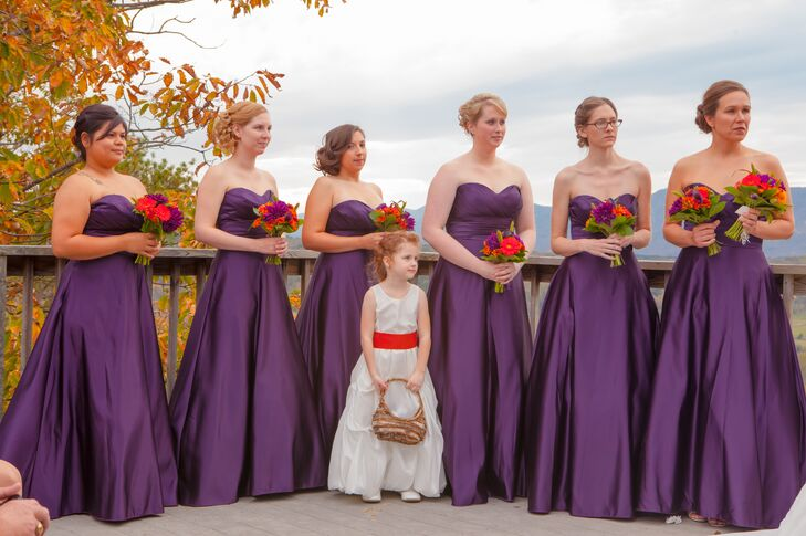 Amanda's bridesmaids wore strapless, floor length satin dresses from Demetrio in purple for the rustic fall wedding.