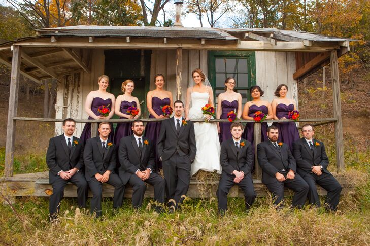 The groomsmen wore black suits with red boutonnieres, which contrasted nicely with the bridesmaids in purple.