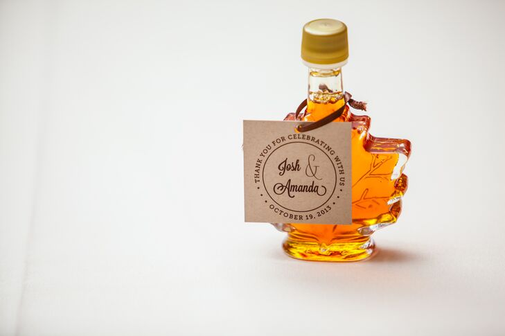 As favors, Amanda and Josh gave their guests small, leaf shaped glass bottles filled with maple syrup.