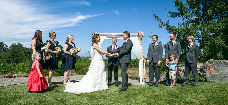 Holding Hands at Outdoor Winery Ceremony