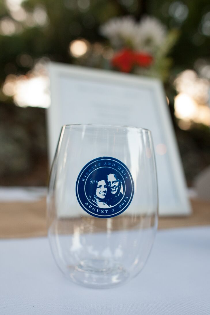 For the guests, the couple made wine glasses customized with a portrait of them in blue and gave them out as wedding favors.