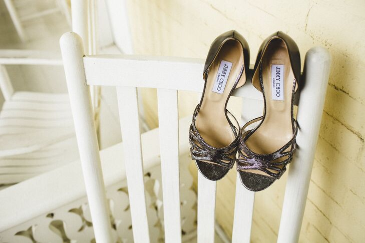 "Kristen's glamorous gunmetal gray heels were the perfect addition to her chic wedding dress. ""I finished off the look with Jimmy Choo's from Saks that were the perfect heel height and color,"" she says."
