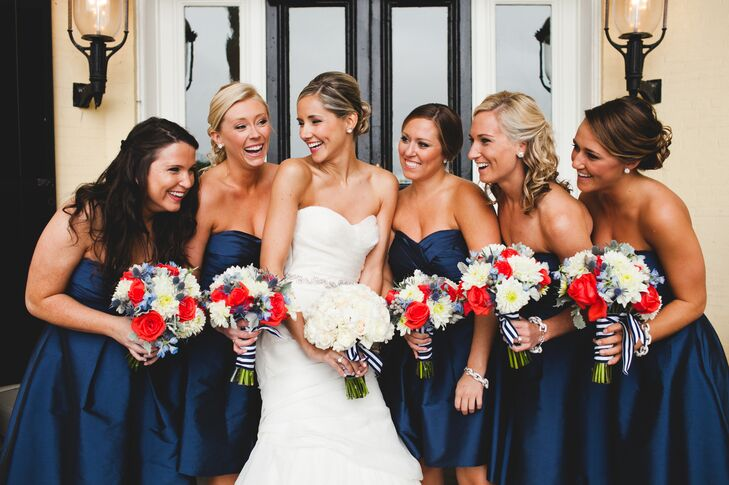 """I was lucky enough to have five amazing, beautiful and smart bridesmaids,"" Kristen says. ""My two best friends and Ken's three sisters were the perfect group to share my wedding day. I gave them all an option to either get different looks from J.Crew in navy or a Monique Lhuillier dress from Bella Bridesmaid. Funny enough, they all chose the Monique Lhuillier dress and it