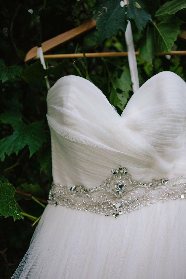 Jessica's lovely A-line tulle gown featured a ruched bodice with an ornate jewel belt.