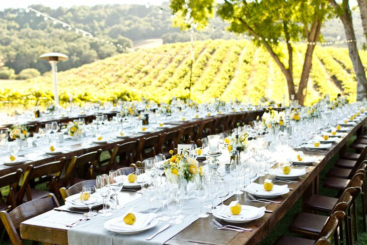 White linens and bright yellow blooms popped against the rustic farm tables. The surrounding trees and bistro lighting set a warm and intimate mood.