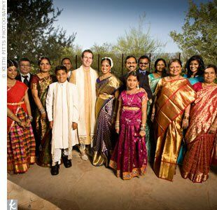 Andrew and Harini's extended family dressed in colorful saris and suits.