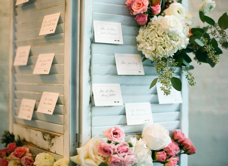 Reclaimed props, like vintage shutters used to display the couple's handwritten escort cards, were incorporated throughout to set a charming, old world tone.
