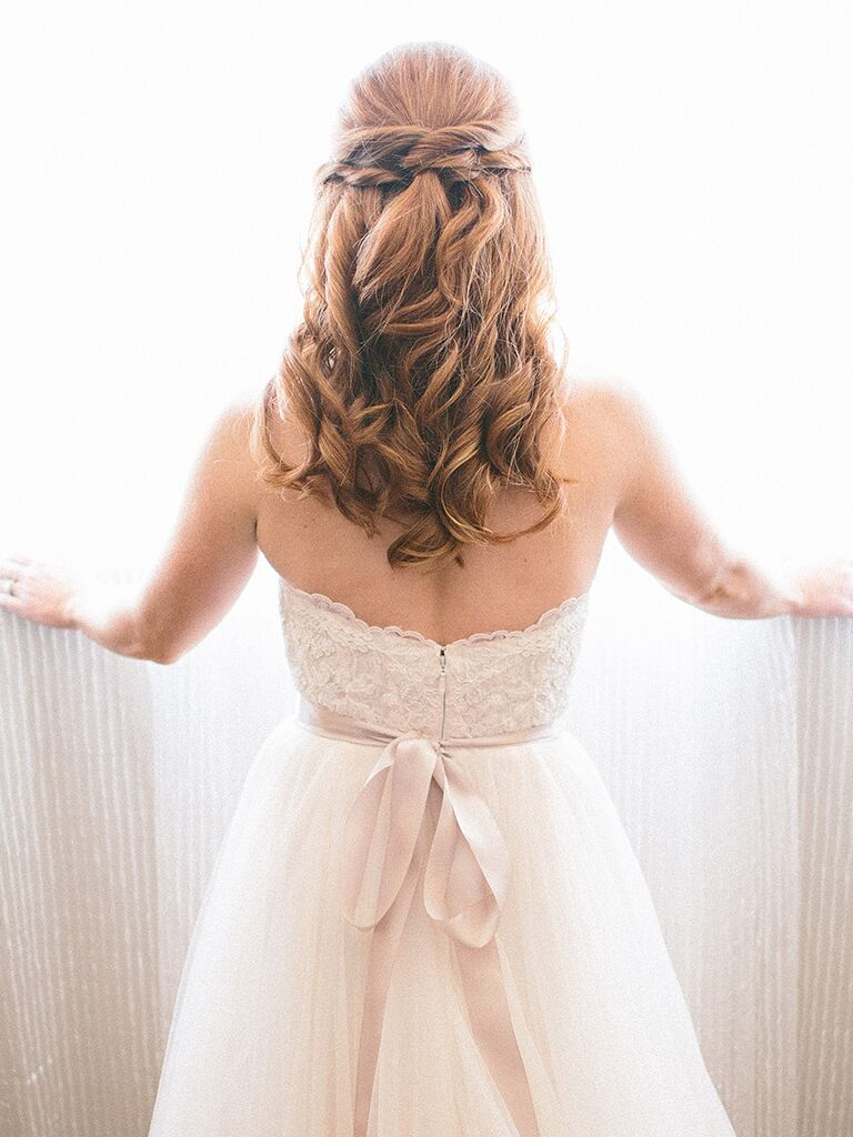 Long wedding hairstyle with curls and braids