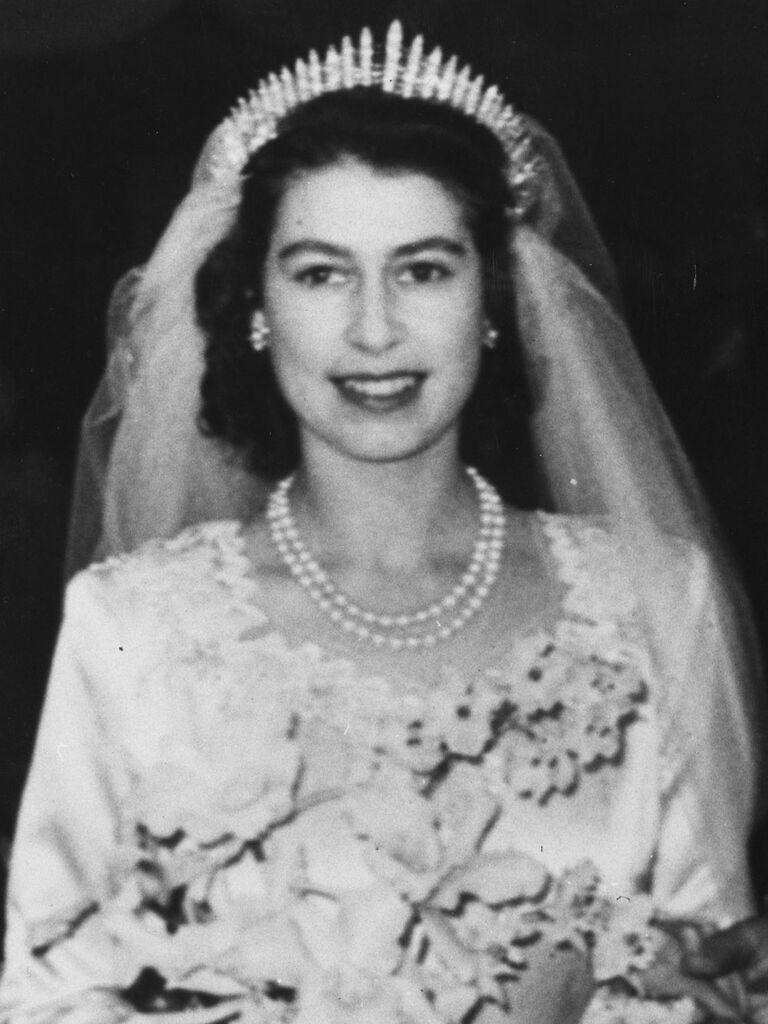 Closeup bridal portrait of Queen Elizabeth wearing tiara and pearls on wedding day