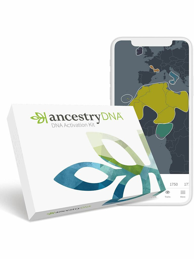 AncestryDNA kit and phone showing map of results