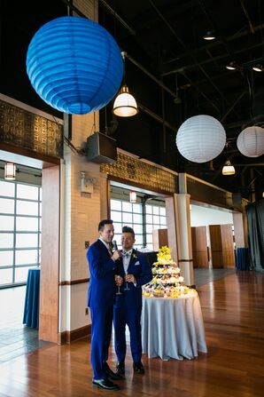 Grooms Give a Speech to Their Guests Under White and Blue Lanterns