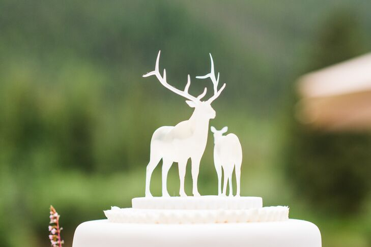Sasha's sister used a 3-D printer to create the white deer cake topper for the couple's four-tier forest-themed wedding cake.