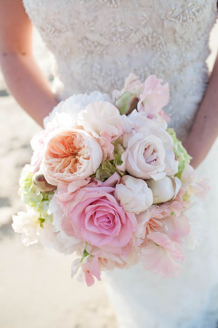 Renee Landry Events created this stunning bouquet for Ryan to carry down the aisle. It included pink roses, peach garden roses, green hydrangeas, blush sweet peas and pink peonies. With its combination of textures and pastel colors, it was perfect for the formal seaside affair.