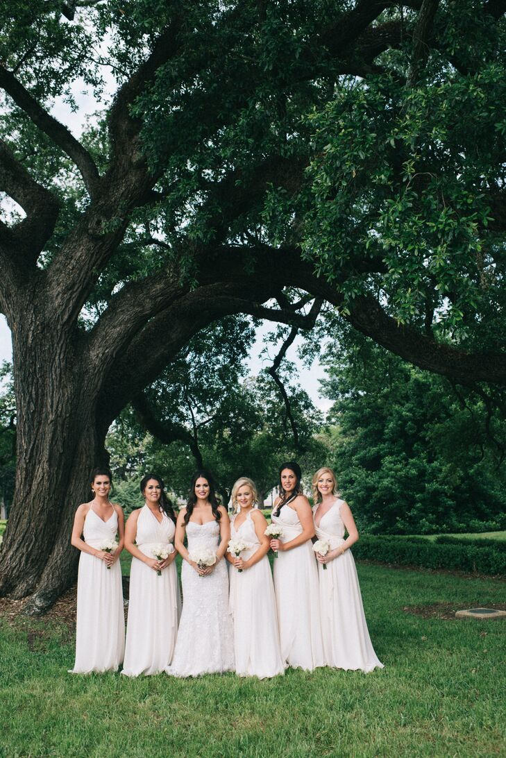 """When looking for bridesmaid dresses, I was looking for a silver, then one of the girls put on a white dress by Joanna August and it looked amazing,"" Dawn says. ""So we went with white wrap dresses, and each had a different top."" Each had different hairstyles as well."